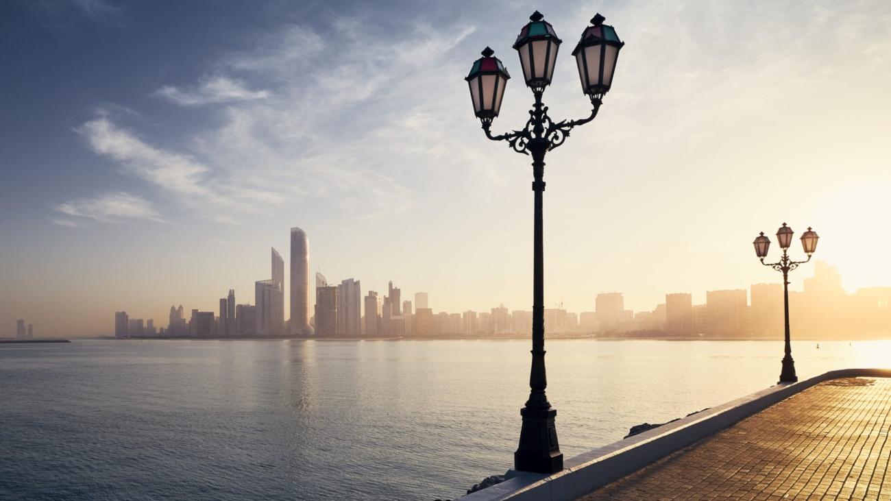 Urban skyline with skyscrapers at beautiful sunrise. Cityscape Abu Dhabi, United Arab Emirates.